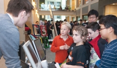 CS students explain their research to children at BOOM (Bits on our Mind)