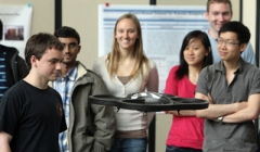 Student demonstrates his robotics research with a flying quadcopter